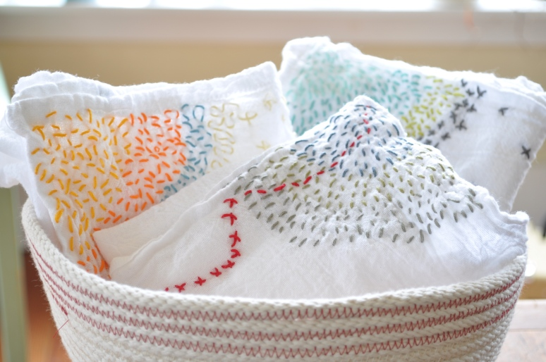 An assortment of tea towels in a rope bowl I will talk about sometime soon.